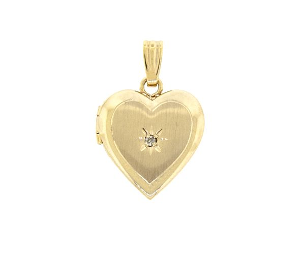 Pendentif loquet coeur 10k 0,015 diamant i1