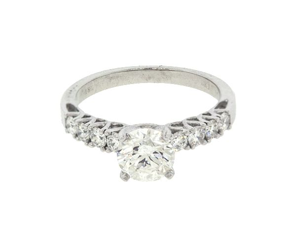 Bague dame en or 18k blanc sertie d'un diamant canadien et de 8 diamants