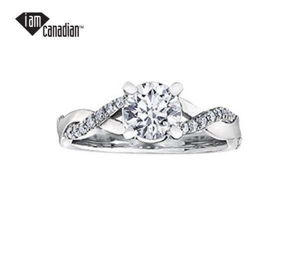 Bague dame or 18k blanc sertie d'un diamant canadien et de 20 diamants