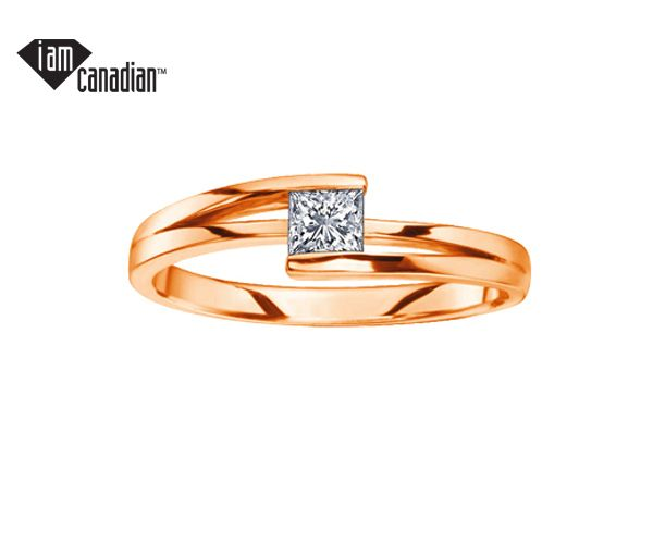 Bague dame en or 14k rose sertie d'un diamant princesse