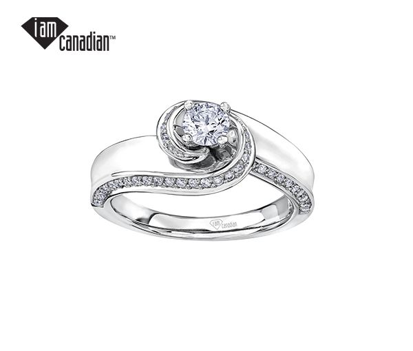 Bague dame or 14k blanc sertie d'un diamant canadien et de 62 diamants