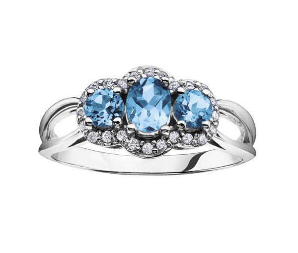 Jolie bague pour dame en or 10k blanc sertie de diamants et de topazes bleus