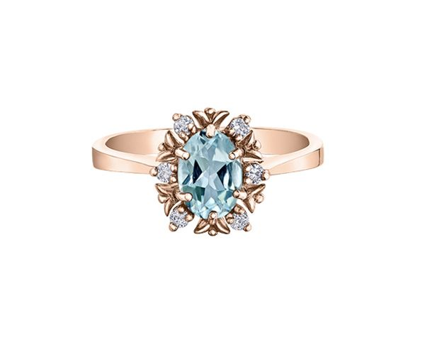 Superbe bague pour dame en or 10k rose sertie d'un zircon bleu et diamants