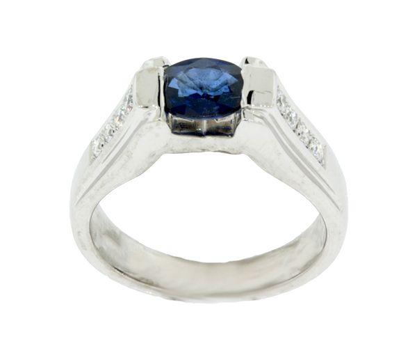 Magnifique bague pour dame en or 18k blanc sertie de diamants et d'un saphir bleu