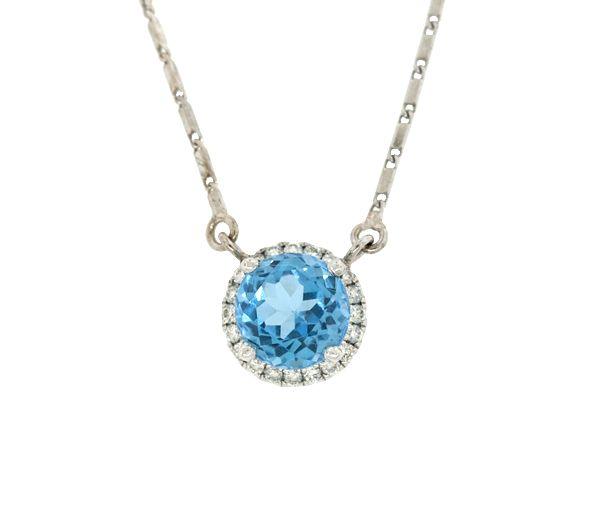 Magnifique pendentif pour dame en or 10-14k serti d'un topaze bleu et de diamants