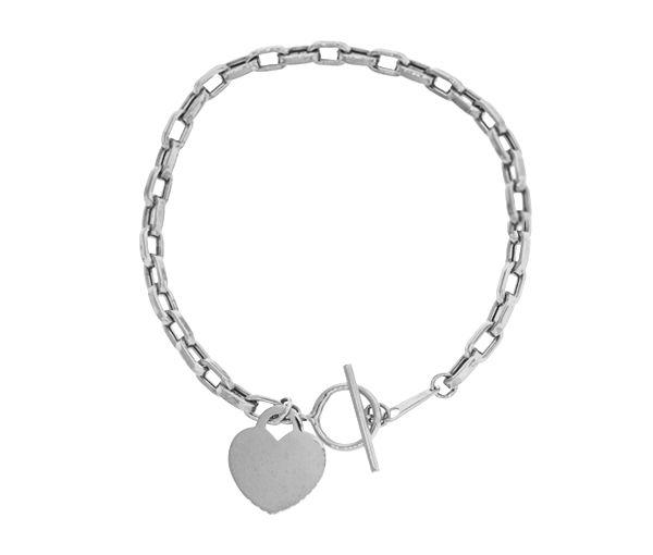 Bracelet avec breloque coeur en or 10k blanc