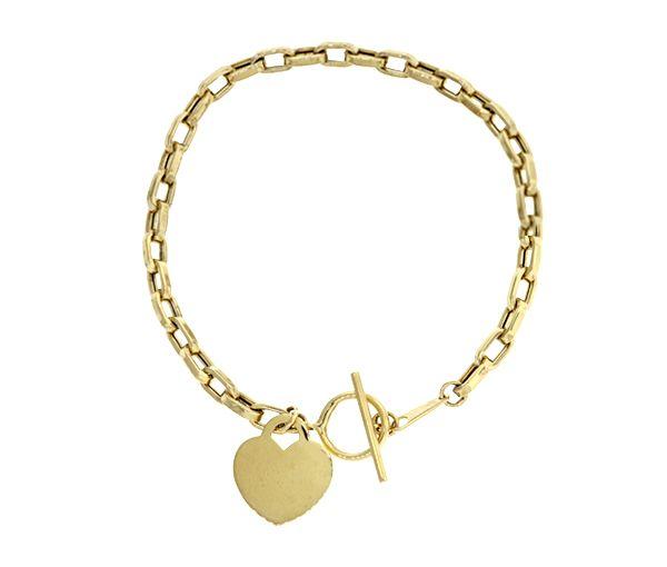 Bracelet avec breloque coeur en or 10k